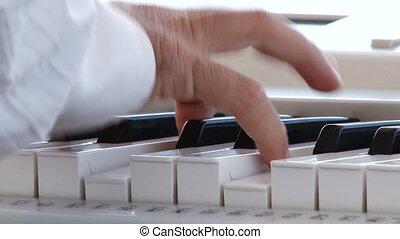 Man play music keyboard, back