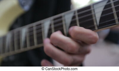man play on electric guitar before concert