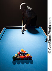 Man playing a game of pool