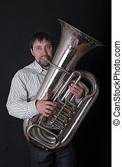 man playing a tuba
