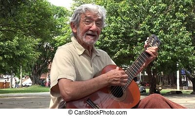 Man Playing Acoustic and Singing