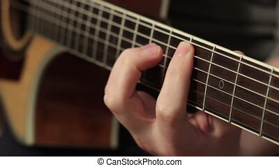 man playing acoustic guitar close up - playing on the...