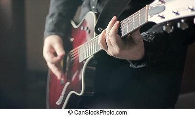 Man playing acoustic guitar