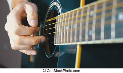 Man Playing an Acoustic Guitar. Slow motion. Close-up neck...