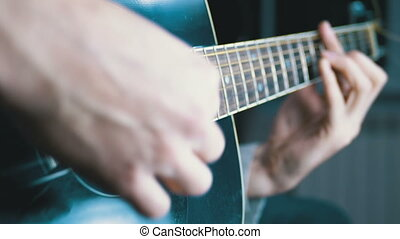 Man Playing an Acoustic Guitar. Slow motion