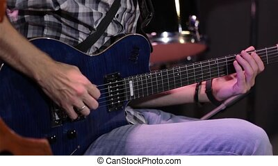 Man Playing An Electric Guitar - Male hands playing blue...