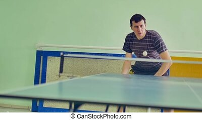 man playing athlete sport table tennis slow motion video backhand