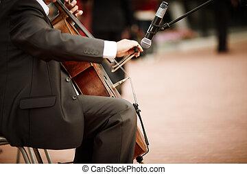 cello - man playing cello on the concert, selective focus