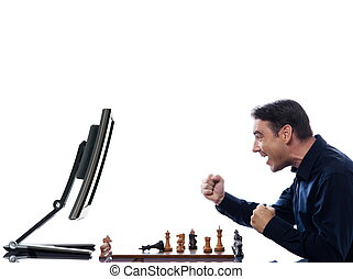 Man playing chess against computer