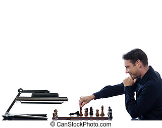 Man playing chess against computer - caucasian man playing...
