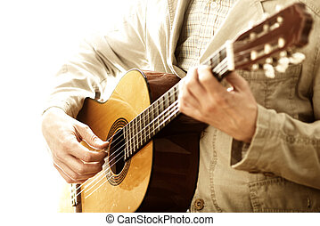 Man playing classical guitar - Man in velvet suit playing...