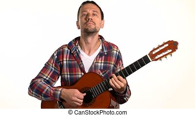 man playing classical guitar close up