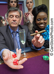 Man playing craps