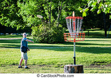 man playing disc golf