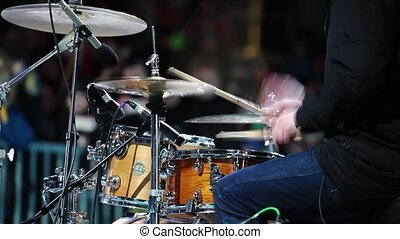 Man playing drums on concert close up view