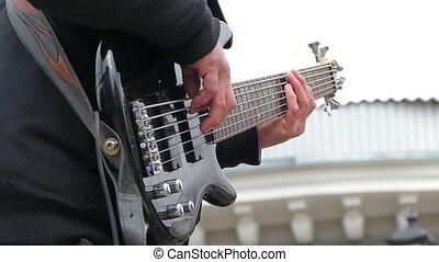Man playing electric guitar strings. Slow motion. - A man...