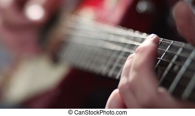 Man playing electric guitar with bend technique - Close up...