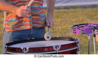 Man playing ethnic drum on street - Unrecognizable man...