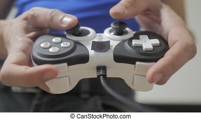 man playing gamepad hands video console on tv. Hand hold...