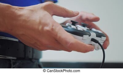 man playing gamepad hands video console on tv. Hand hold new...