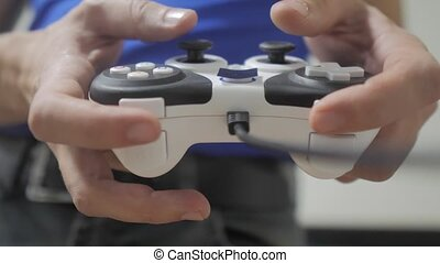 man playing gamepad lifestyle hands video console on tv....
