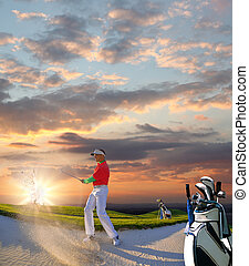 Man playing golf against colorful sunset
