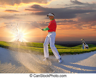 Man playing golf against sunset
