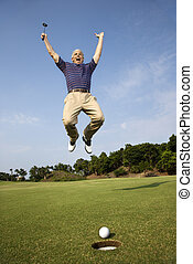Man playing golf. - Caucasion mid-adult man holding golf...