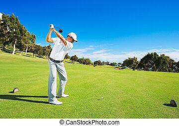 Man Playing Golf - Golf player teeing off. Man hitting golf...