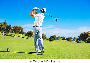 Man Playing Golf - Golf player teeing off. Man hitting golf...