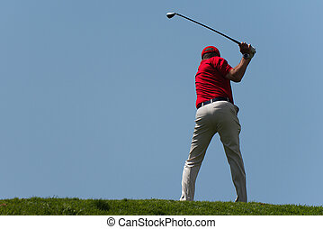Man playing golf on beautiful sunny green golf course