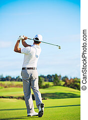 Man Playing Golf on Beautiful Sunny Green Golf Course. ...
