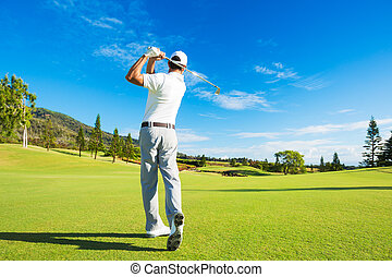 Man Playing Golf - Golfer Hitting Golf Shot with Club on the...