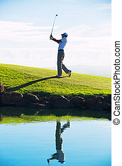 Man Playing Golf - Silhouette of Man Playing Golf on...