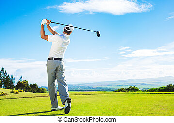 Man Playing Golf on Beautiful Sunny Green Golf Course....