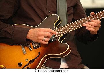 Man playing guitar - A man is playing his guitar.