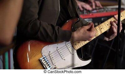 Man playing guitar at club