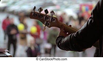 Man playing guitar at concert