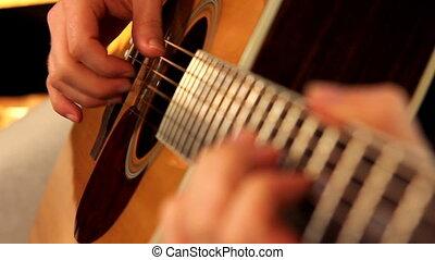 man playing guitar close up 2