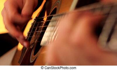 man playing guitar close up 3