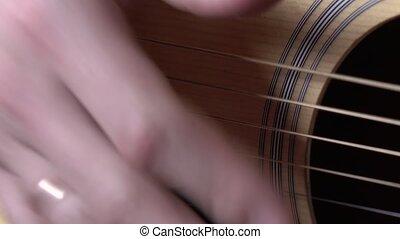 Man playing guitar, close up