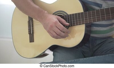 man playing guitar. Close-up of a guitar