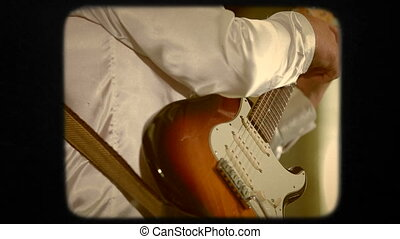 Man Playing Guitar. Close-up. Retro