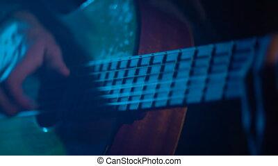 Man playing guitar close-up