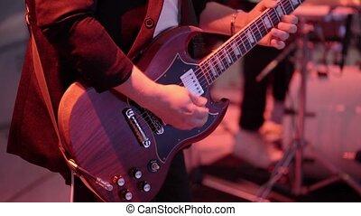 Man playing guitar on concert
