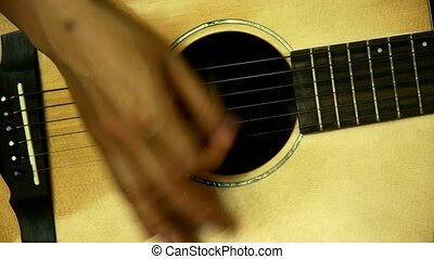 man playing guitar, strum.