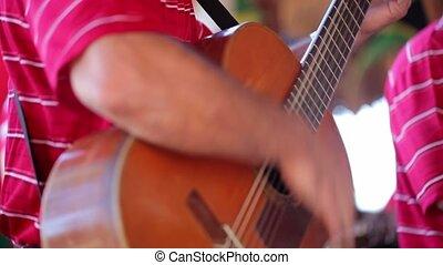 Man playing guitar - Unrecognizable man playing guitar...