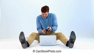 Man playing joystick game on laptop 4k - Man playing...