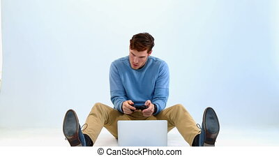 Man playing joystick game on laptop 4k - Man playing...