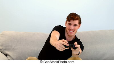 Man playing joystick game on sofa 4k - Man playing joystick...